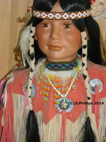 Twisted braids, bead work on doll