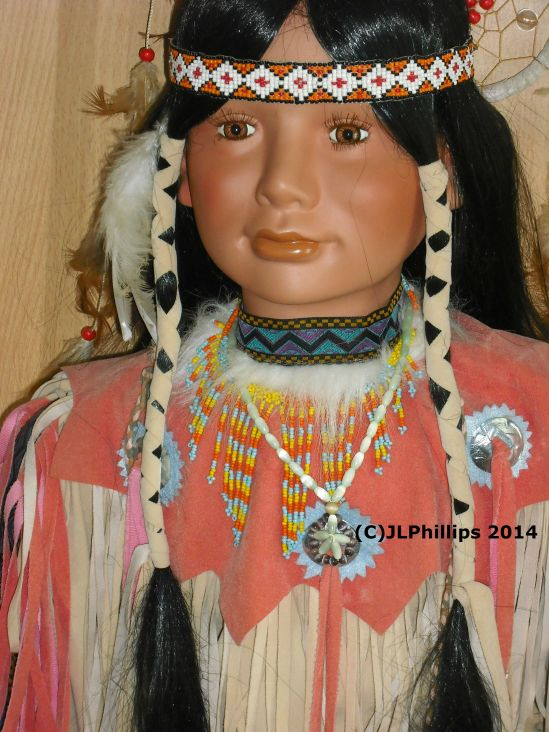 Twisted braids, bead work on doll