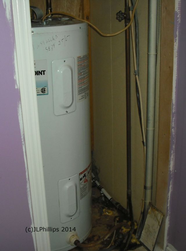 Our itty bitty water heater closet