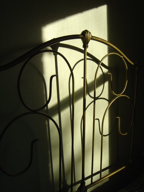 antique_headboard_in_sunbeam